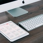 iMac and iPad on wooden desk